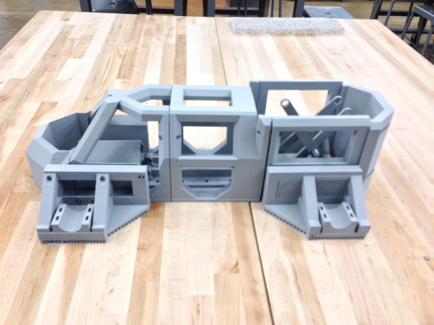 Image of the individual pieces of the 3D printed exoskeleton during fabrication.