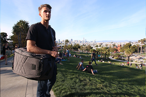 Guy with paq bag in duffle mode in park