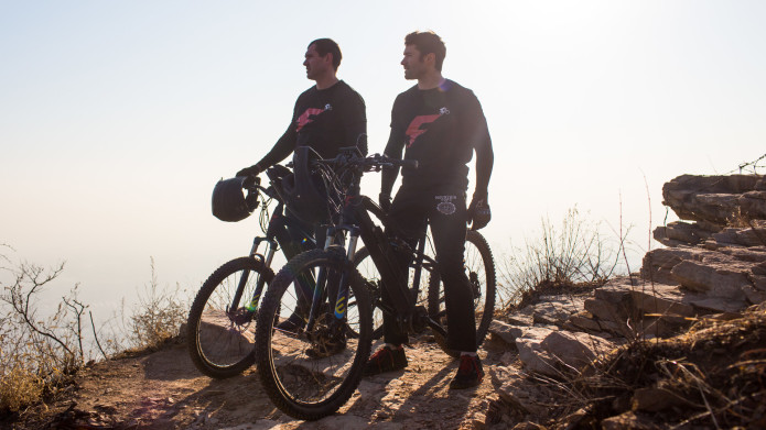 FLX Bike founders Rob Rast and Pete Leaviss on a Cliff - 2015