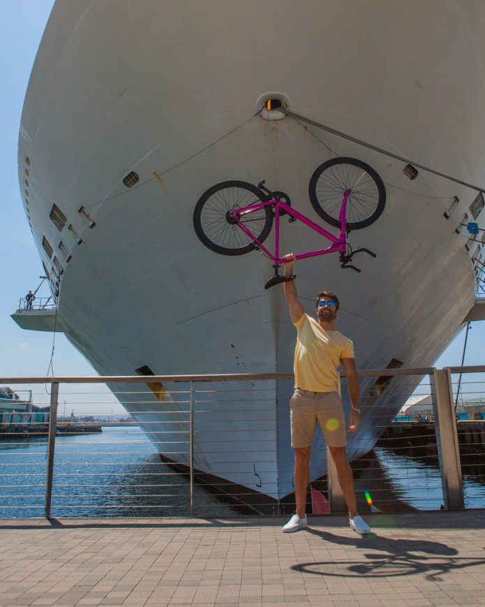 Rob Rast Holding the FLX Babymaker Electric Road Bike Overhead